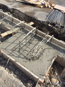 Concrete is poured for south rink foundation, footings